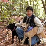 Sunvet, Asheville holistic vet's staff member Caren Harris and dog friends