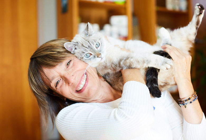dr Laurel Davis playing with Siamese cat
