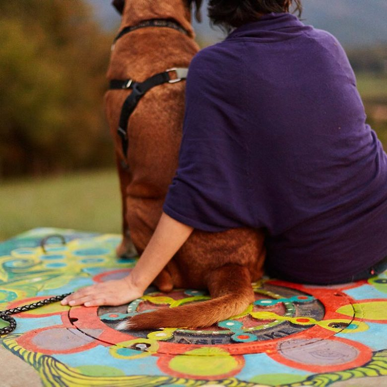 woman and dog sit together