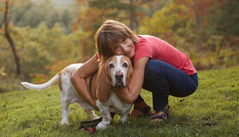 dr. Laurel hugs senior basset hound