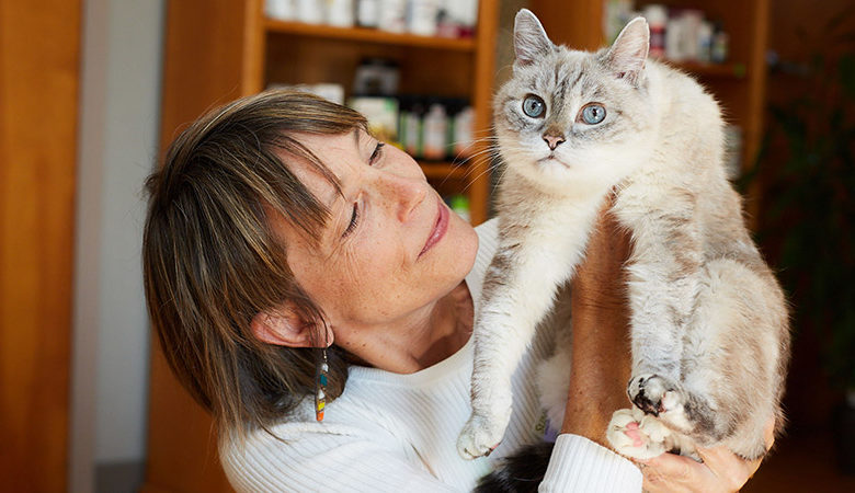 Dr. laurel Davis holds gray cat with blue eyes